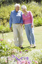Senior couple walking in garden Stock Image