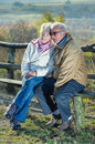 Senior couple walking in park Royalty Free Stock Photos