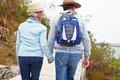 Senior couple walking together by a lake Royalty Free Stock Photo