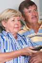 Senior couple watching television Stock Images