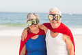 Senior couple wearing superman costume Royalty Free Stock Photo