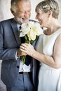 Senior Couple with White Roses Flower Bouquet Royalty Free Stock Photo