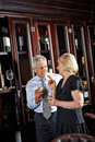 Senior couple at wine tasting happy together a event Royalty Free Stock Photo