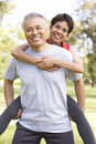 Senior Couple Working Out In Park Stock Photo