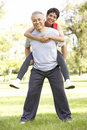 Senior Couple Working Out In Park Stock Image