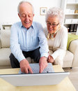 Senior couple working together on laptop Stock Photos