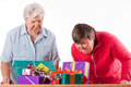 Senior with daughter consider gifts Stock Photography