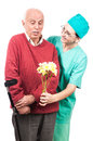 Senior disabled man congratulated flowers surprise nurse person with crutch receiving from female healing victory Stock Photography