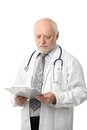 Senior doctor looking at papers Royalty Free Stock Photos