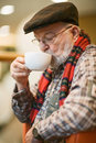 Senior Drinking Coffee Stock Images