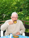 Senior drinking a coffee Stock Images