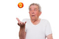 Senior eat healthily fruit throwes an apple in the air Royalty Free Stock Image