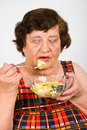 Senior eating  potato salad Stock Image