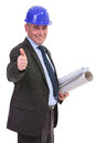 Senior engineer showing thumb up ok sign holding some blueprints and while smiling to the camera isolated on white background Royalty Free Stock Photo