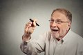 Senior excited man writing something with pen on blackboard portrait happy education concept Stock Image