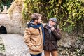 Senior father and his young son on a walk. Royalty Free Stock Photo