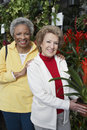 Senior Female Friends At Botanical Garden Royalty Free Stock Images
