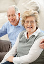 Senior female with a happy mature woman at home Royalty Free Stock Image