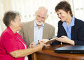 Senior Financial Advice - Sign Here Stock Image