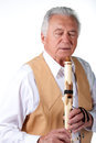 Senior with flute Stock Images