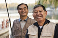 Senior friends portrait while fishing at a lake Royalty Free Stock Photo