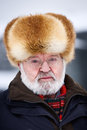 Senior in fur hat Stock Image