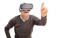 Senior gentleman experiencing virtual reality and reaching to touch something with his finger isolated on white background Stock Photos