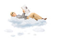 Senior gentleman reading newspaper laying on clouds isolated white background Royalty Free Stock Image