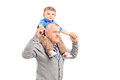 Senior giving a piggy back ride to his grandson isolated on white background Stock Photo