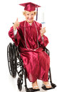 Senior graduate in wheelchair thumbs up lady a earns her college degree and gives a full body isolated on white Royalty Free Stock Photography
