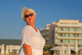 Senior grey haired woman staying near building Royalty Free Stock Photo