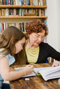 Senior halping child doing homework Stock Photos