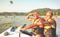 Senior happy couple having fun on jet ski at beach island hopping Royalty Free Stock Photo