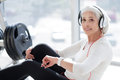 Senior happy woman exercising and listening to music Royalty Free Stock Photo