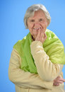 Senior happy woman with grey hairs against blue background Royalty Free Stock Photos