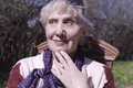 Senior happy woman portrait of a dreamily looking outdoor shot Royalty Free Stock Photos