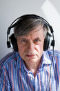 Senior with headphones Royalty Free Stock Images