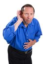 Senior hearing loss senile adult male cups his hand to the ear because of a of problem Royalty Free Stock Images