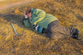 Senior hiker has short rest lying on the roadside Royalty Free Stock Photo