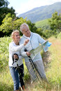 Senior hikers with map in countryside Royalty Free Stock Photo