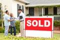 Senior Hispanic couple buying new home Royalty Free Stock Photo