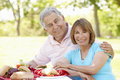 Senior hispanic couple enjoying picnic in park Royalty Free Stock Photos