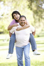 Senior Hispanic Couple Having Fun In Park Royalty Free Stock Photo