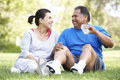 Senior Hispanic Couple Resting After Exercise Royalty Free Stock Photos