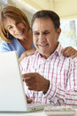 Senior hispanic couple using laptop in home office Royalty Free Stock Photography