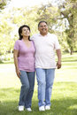 Senior Hispanic Couple Walking In Park Royalty Free Stock Photography
