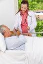 Senior in hospital taking medicine Royalty Free Stock Image