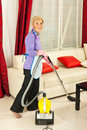 Senior housewife cleaning house Stock Images