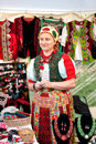 Senior hungarian ethnic woman wearing traditional costume cluj napoca romania selling handcrafts at the fair zilele clujului Royalty Free Stock Photo