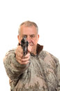 Senior hunter in sage camo with revolver pointed at viewer isolated on white Stock Photography